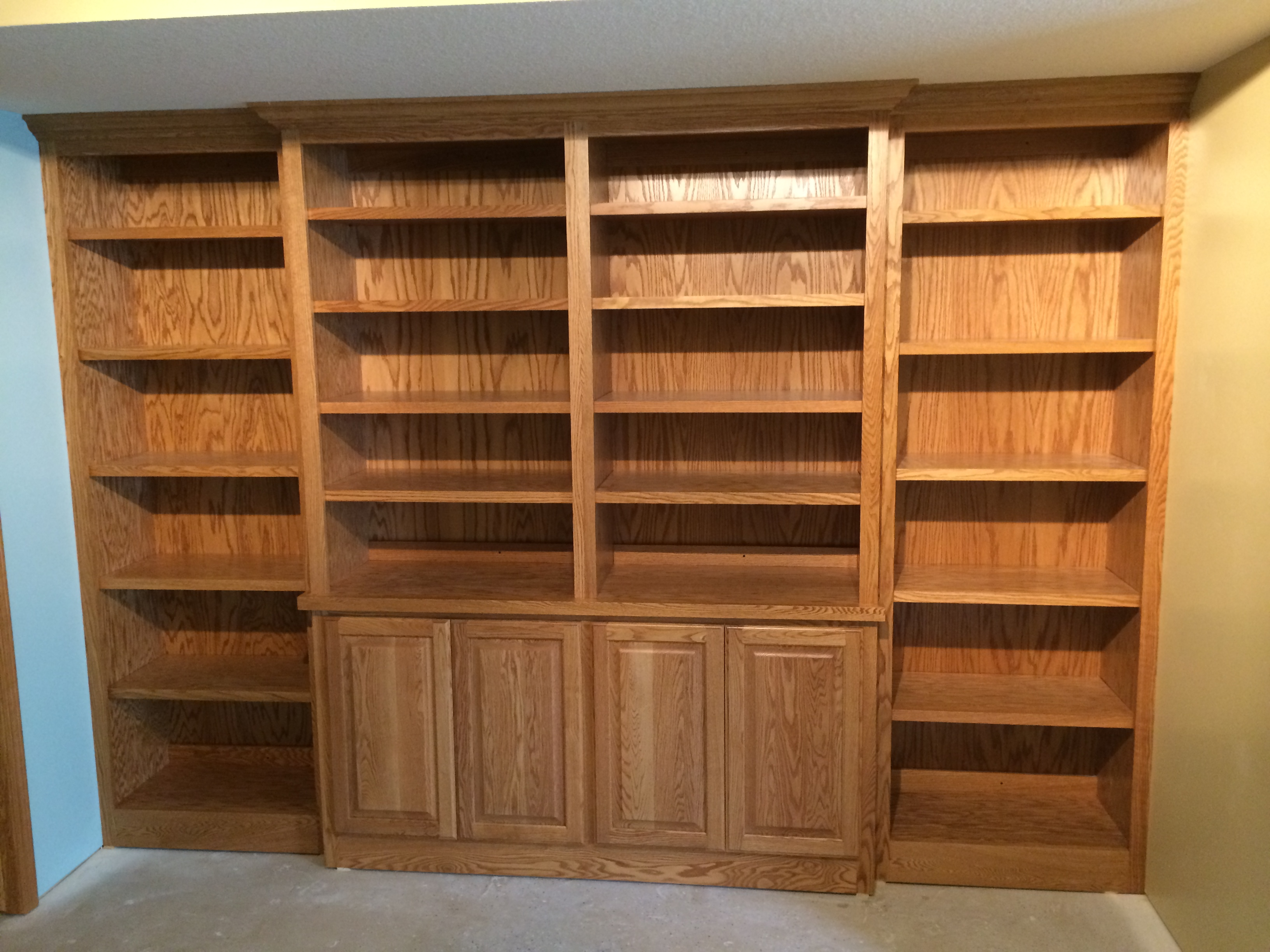 Valley custom cabinets basement remodel 1 this red oak built in bookcase with raised panel doors vtopaller Gallery